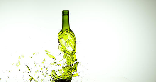 Bottle of White Wine Breaking and Splashing against White Background, Slow motion 4K Live Action