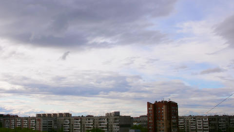 Clouds above city skyline. Clouds moving over blue sky. HD Time lapse Footage