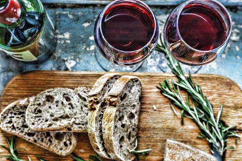 Red wine and snacks. Christmas, Thanksgiving, wine, Parmesan, rosemary, bread. Photo
