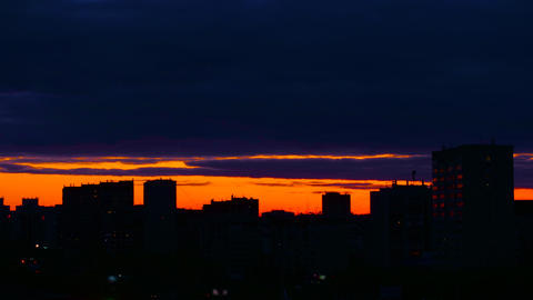 City during warm sunset. Background with sunset skyline. City evening timelapse Live Action