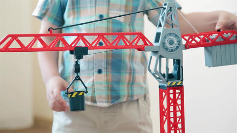 Boy playing construction crane, raise and lower the load Footage
