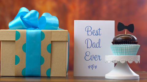 Happy Father's Day close up of woman arranging and setting up gift, cupcake and Footage