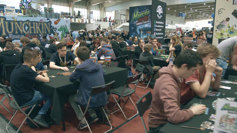 POZNAN, POLAND - MAY 19, 2018. Young people playing board games at Pyrkon Footage