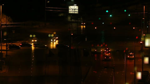 Cars stopping at crossroads and moving in big city, night view, time-lapse Footage