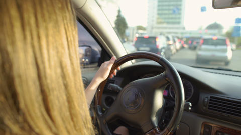 Brunette female standing in a traffic jam. Woman driving automobile. Transport Live Action