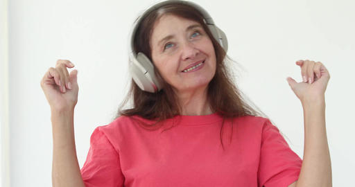 Elderly women in headphones dancing Footage