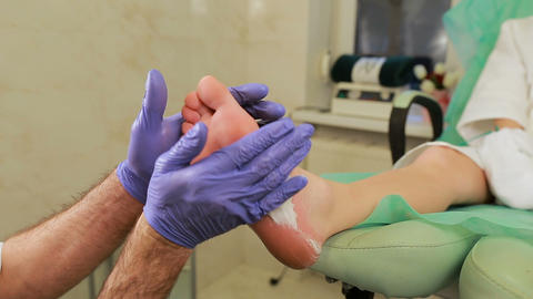 Pedicure Foot Care Applying Emollient Foam. Foot massage at Spa Live Action