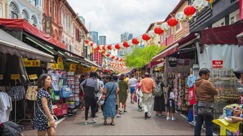 Visitors are travelling in China Town market street in Singapore city, Singapore Live Action