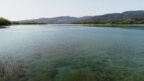 Aerial drone view of lake Banyoles in Girona Catalonia Spain Footage