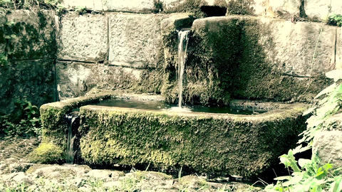 An old memorial fountain with drinkable water in mountain close up ビデオ