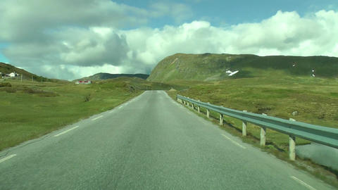 Driving a car on a road in Norway. Beautiful landscape Live Action
