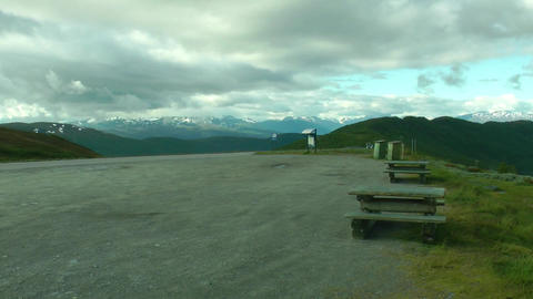Close up side of car parking on the mountain road. Road in the mountains. Norway Footage