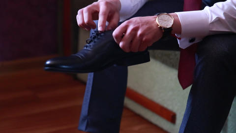 close-up, the groom wears stylish shoes at the wedding Live Action