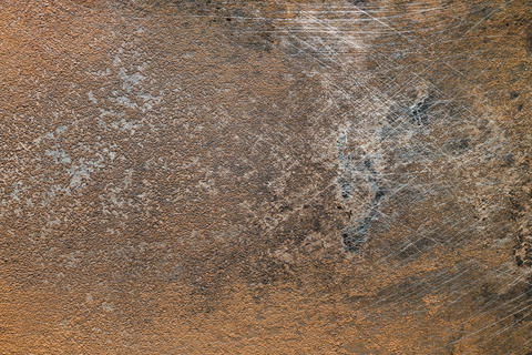 Textured metal surface with traces of corrosion フォト