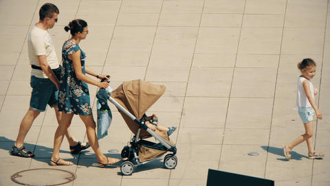 WARSAW, POLAND - MAY 31, 2018. Family walking with a stroller on a sunny day Footage