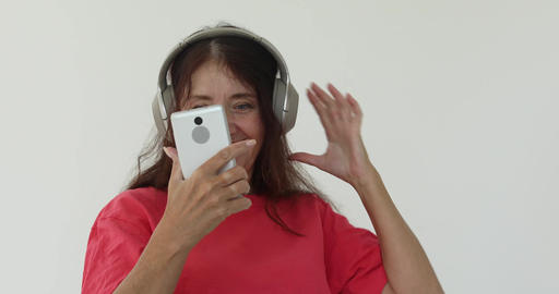 Mature woman with smartphone listening to music Footage
