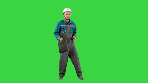 Funky and successful engineer, manager or architect dancing and having fun on a Footage