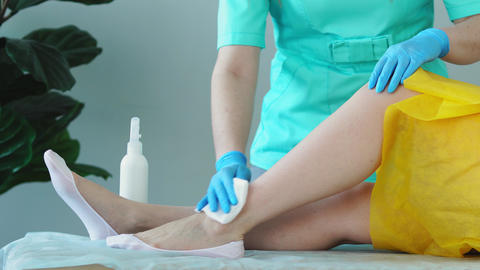 Closeup of the master of hair moisturizing remedy irritation performing foot Live Action