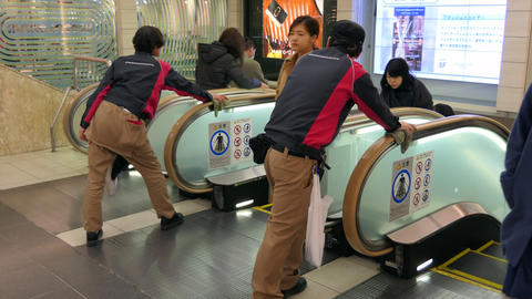 Staff Workers Cleaning Escalator Handrails In Train Station Tokyo Japan Footage