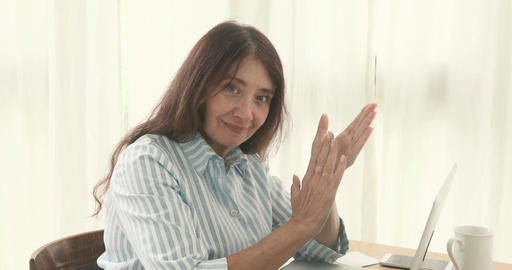 Mature woman applauds Clapping for Success Footage