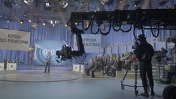 TV Studio with a presenter and the audience during the broadcast Footage