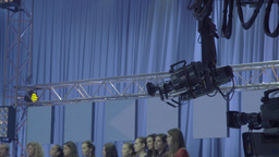 The camera shoots in the TV Studio with spectators Footage