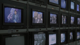 A lot of TV monitors with live during the broadcast Footage