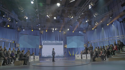 TV Studio with the audience and a presenter during the live broadcast Footage