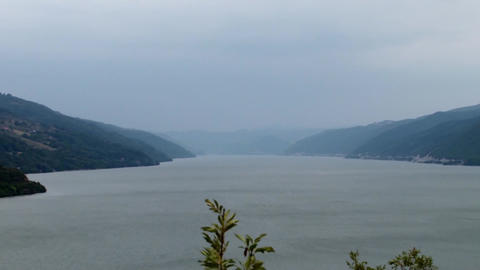 Danube river seen from a high mountain seen in length, bordered by hills and tow Footage