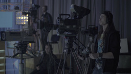 Cameramen work in a TV Studio during a live broadcast Footage