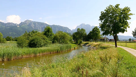 Sunny landscape with river in the Bavarian Alps Footage