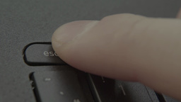 """Finger presses the """"Escape"""" on the keyboard laptop (computer) Footage"""