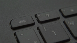 Closeup of finger presses the Escape button on the keyboard Live Action