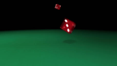 Red dice rolling on green casino table Stock Video Footage