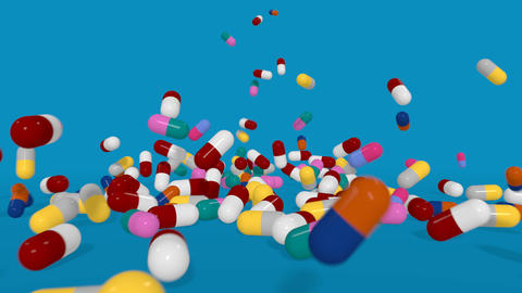 Multiple Color Pills Falling in Slow Motion on a Blue Background. 3D animation Animation