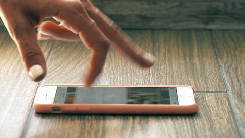 Female fingers on a cell phone imitate treadmill runner Footage