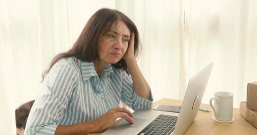 Mature bored woman in home office Footage