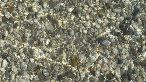 abstract background from light refraction of water and pebble on bottom Live Action