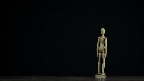 Stopmotion wooden figure dummy in studio on black... Stock Video Footage
