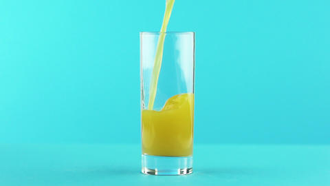 Slow motion close-up shot of fruit orange multifruit juice cold beverage drink Live Action