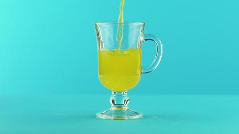 Slow motion close-up shot of fruit fizzy orange soda cold beverage drink pooring Footage