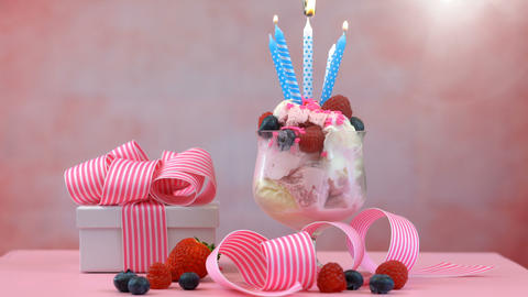 4k Pink Ice Cream Sundae with birthday candles and gift on a summery feminine Live Action