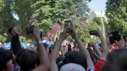 People with phone into hands records video on background crowd at festival in Footage