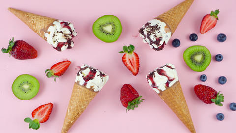 Summertime berry and chocolate Ice cream cones overhead flat lay with fresh Footage