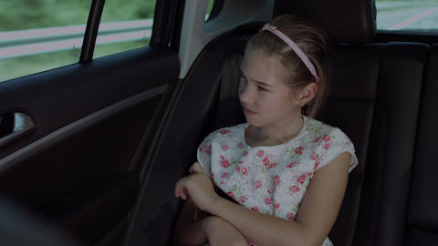 Lovely girl looking through car window during trip Footage