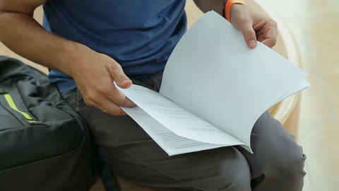 Host of tv program reading script before shooting, student preparing for exam Live-Action
