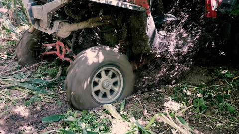 A jeep rides back through the mud Live Action