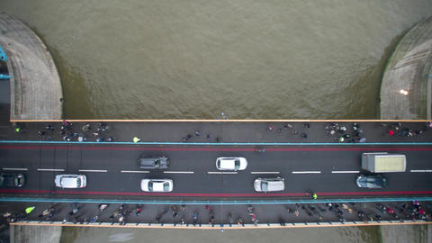 Traffic and pedestrians flow across Tower Bridge Footage