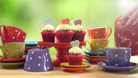 4k Colorful Mad Hatter style tea party with cupcakes and rainbow colored polka Live Action