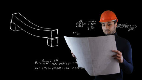 A man in safe helmet read blueprints in the flying out black calculations Live Action